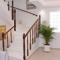 Interior staircase leading to bedrooms on 1st floor